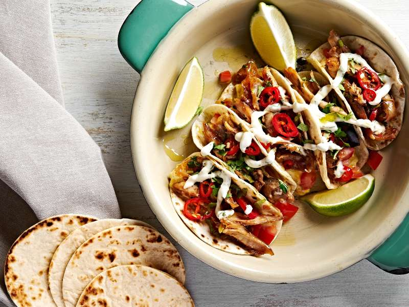 Mexican pulled chicken open tortillas